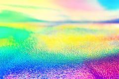 彩虹真正的全息照相的箔霓虹纹理墙纸 库存图片