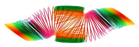 彩虹线圈弹簧玩具 库存照片