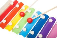 彩虹色的玩具木琴,在白色 免版税库存照片