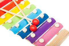 彩虹色的玩具木琴,隔绝在白色 免版税库存照片
