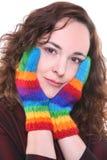 彩虹色的被编织的手套 库存照片