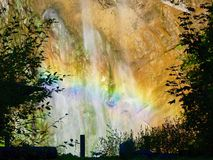彩虹unter在山Alpen Jungfraujoch的瀑布 库存照片
