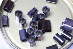 影片在一个圆的金属罐头的档案阴性 库存图片