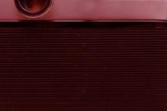 影片照相机的后面部分与盖子的 宏指令 抽象背景同类的照片结构葡萄酒 定调子 免版税库存图片
