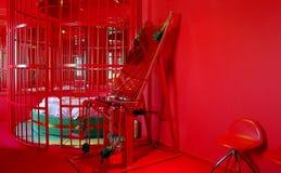 奴役椅子笼子和床 免版税图库摄影