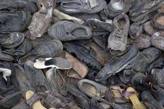 很多老垃圾鞋子 背景概念能源图象 图库摄影
