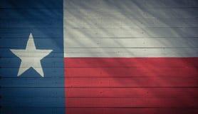 得克萨斯在木板纹理的旗子样式 免版税库存照片