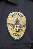 得克萨斯奥斯汀警察徽章的首都 库存图片