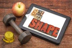得到在形状在片剂的健身概念 图库摄影