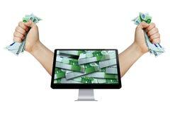 得到富有的金钱技术显示器计算机Iso 图库摄影