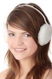 御寒耳罩女孩相当青少年的佩带的白&# 免版税库存照片