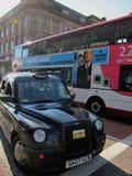循环运行汽车在格拉斯哥市,苏格兰 库存照片