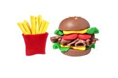 微型乳酪汉堡和土豆油煎的模型 库存图片