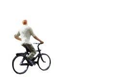 微型图被隔绝的乘驾自行车在白色背景 图库摄影