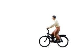 微型图被隔绝的乘驾自行车在白色背景 库存照片