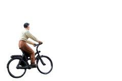 微型图被隔绝的乘驾自行车在白色背景 免版税库存图片