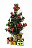 微型圣诞树和礼物 免版税库存照片