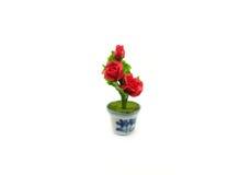 微型在罐的黏土玫瑰色花 免版税图库摄影