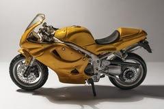 微型黄色体育摩托车 免版税库存图片