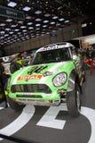赛跑达喀尔2013年优胜者-日内瓦汽车展示会的微型ALL4 2013年 库存照片