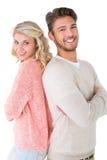 微笑与胳膊的有吸引力的夫妇横渡 图库摄影