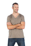 微笑与胳膊的英俊的人横渡 图库摄影