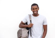 微笑与袋子的大学生 免版税库存照片