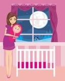 微笑与婴儿的美丽的妇女 库存图片