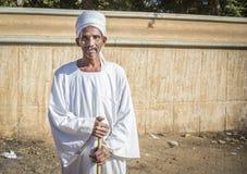 微笑为照相机的苏丹人人 库存图片