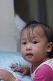 微笑亚洲女孩小孩使用 库存照片