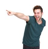 微笑和指向手指的人 免版税库存照片