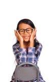 微笑和接触她的面颊的小女孩 库存图片
