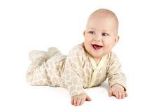 微笑和显示他的第一颗牙的滑稽的男婴 免版税库存照片
