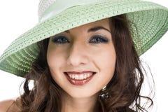 微笑和绿色帽子 库存照片