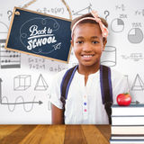 微笑在学校走廊的小女孩的综合图象 免版税库存照片