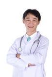 微笑在白色背景的愉快的医生画象 库存图片