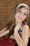 微笑在葡萄酒样式的女孩作为七十 库存图片