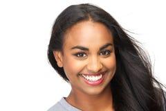 微笑在被隔绝的白色背景的美丽的少妇 免版税图库摄影