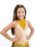 微笑在金黄礼服的Teenger 免版税图库摄影