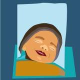 微笑在他的睡眠的一个甜新出生的婴孩 库存照片