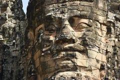 微笑在bayon寺庙的面孔石头 免版税图库摄影