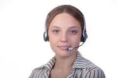 微笑妇女的接近的表面耳机 库存照片