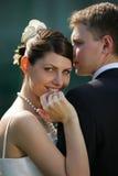 微笑婚礼的新娘接近的日 免版税库存照片