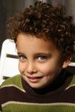微笑对年轻人的男孩照相机 图库摄影