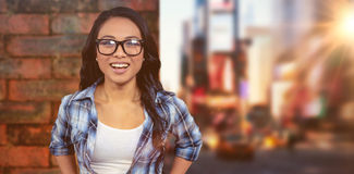 微笑对照相机的亚裔妇女的综合图象 免版税库存图片