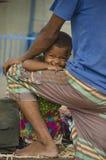 微笑对照相机的小女孩 免版税库存图片