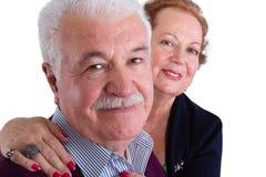 微笑对照相机的愉快的资深企业夫妇 库存照片