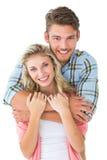 微笑对照相机的有吸引力的年轻夫妇 库存照片