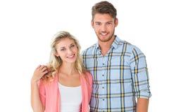 微笑对照相机的有吸引力的年轻夫妇 库存图片