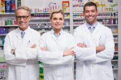 微笑对照相机的药剂师队  免版税库存照片